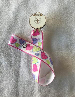 Sheep Dummy Clip W/Multi-Coloured Heart Ribbon